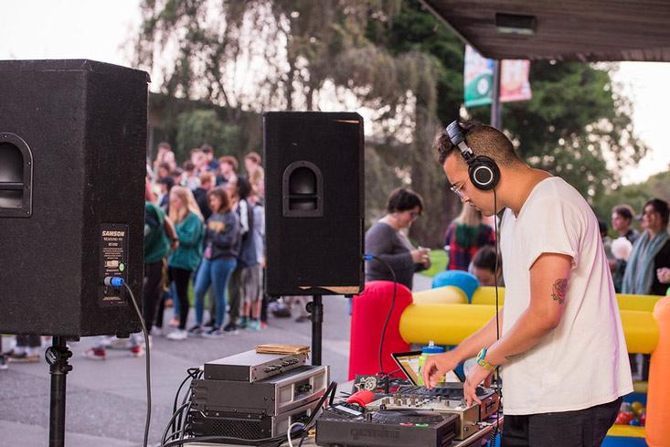 a dj playing music on the quad