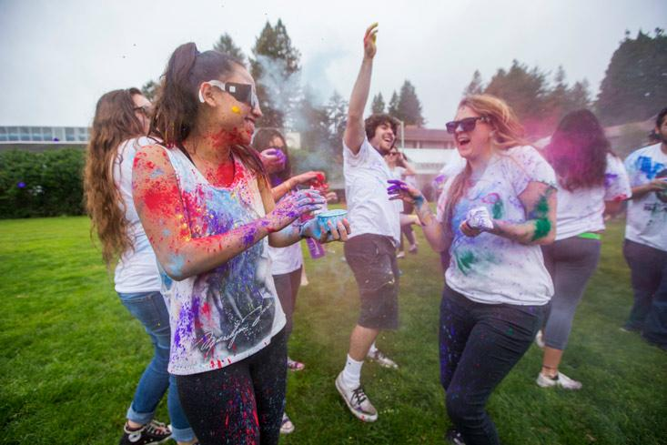 students throwing paint at the Holi Festival