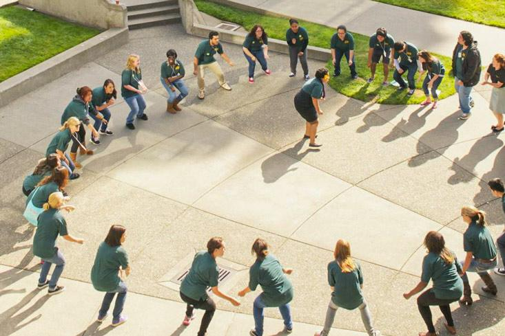 Students in a large circle on the quad