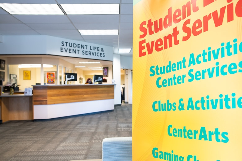 front of the SLES counter with banner sign in the forefront